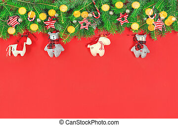 Christmas tree garland with handmade toys ornaments on red