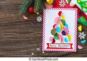 Christmas tree greeting card. Handmade. Project of children's creativity, handicrafts, crafts for kids. Top view. Copy space.