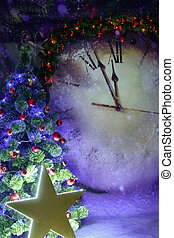 Christmas tree illuminated by a large luminous star on the background of a huge Christmas clock