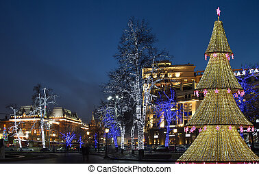 Christmas tree illuminated to Christmas and New Year holidays at night in Moscow, Russia