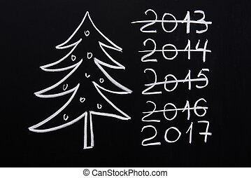 Christmas tree in 2017 on blackboard