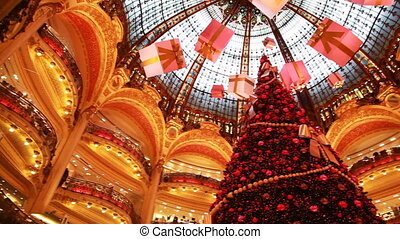 Christmas tree in department Galeries Lafayette Company -...
