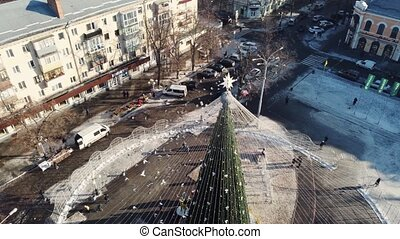 Christmas Tree in the center of Poltava, Ukraine. Aerial drone video of european town in winter