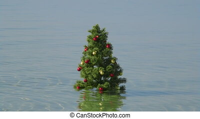 Christmas tree in turquoise water at tropical beach background