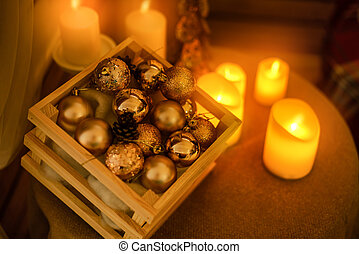 Christmas tree is in the room on the wall hanging garlands, a table by the window with candles