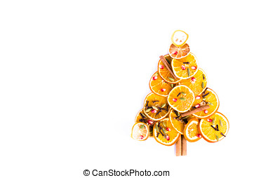 Christmas tree made of dried oranges, lemon, cinnamon, cloves, cardamom on white background. Christmas and New Year decoration frame. Free space for text.