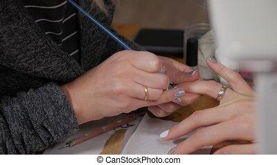 Christmas tree manicure on the nail closeup