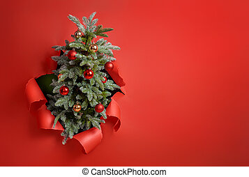 Christmas tree on bright red background.