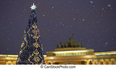 Christmas tree on the Palace Square in St. Petersburg at night.