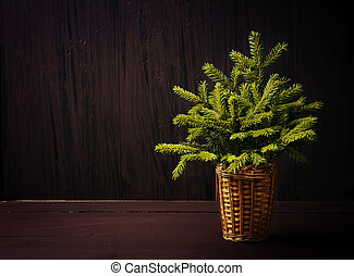 Christmas tree on winter wooden retro background