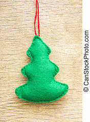 Christmas tree on wooden background