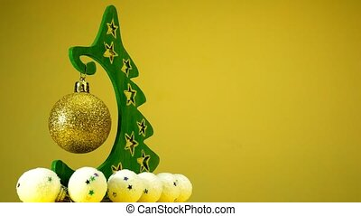 Christmas Tree on Yellow Background with place for your text. Loop