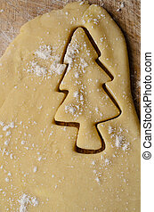 Christmas Tree Shape Cut into Rolled Biscuit Dough -...
