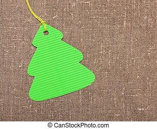 Christmas tree shape label tag on sackcloth
