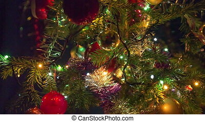 Christmas tree with toys and luminous garlands