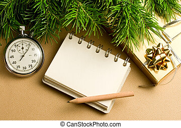 Christmas tree, stopwatch, gift and notepad