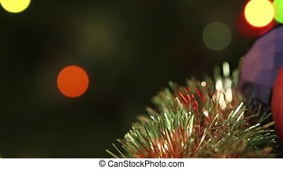 Christmas-tree tinsel garland in the background flashing