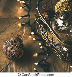 Christmas tree toy decoration balls and light garland, wooden background