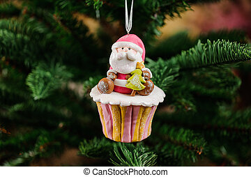 Christmas tree toy in a form of cupcake