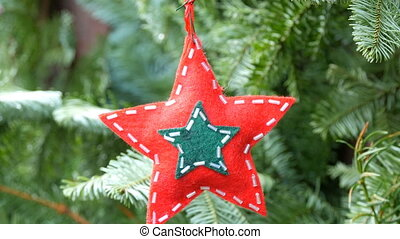 Christmas tree toy in the shape of star of red color from...