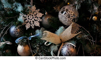 Christmas tree with balls and ornaments silver color