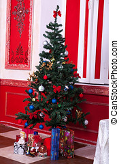 Christmas tree with beautiful toys inside a red vintage room