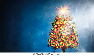 Christmas tree with bokeh lights, blue background