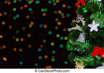 Christmas tree with bokeh. Place for your text.