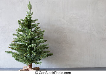 Christmas Tree With Cement Wall As Background, Copy Space
