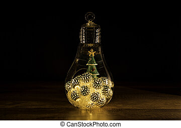 Christmas tree with Christmas lights in glass light bulb