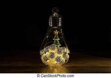 Christmas tree with Christmas lights in glass light bulb
