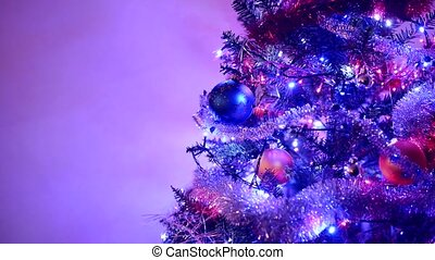 Christmas tree with colorful garland lights, cropped with...