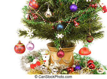 Christmas tree with decorations. Isolated on white
