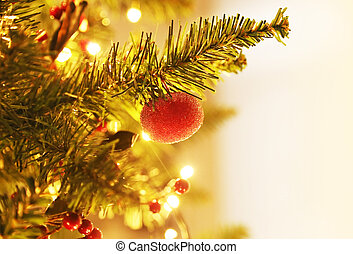 Christmas tree with decorative ornaments, balls and golden lights