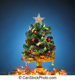 Christmas tree with festive lights, blue background