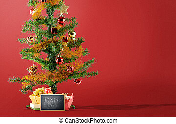 Christmas tree with gift box and Boxing Day text on the blackboard