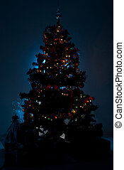 Christmas tree with gifts in night