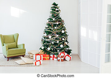 Christmas tree with gifts of the new year holiday winter background