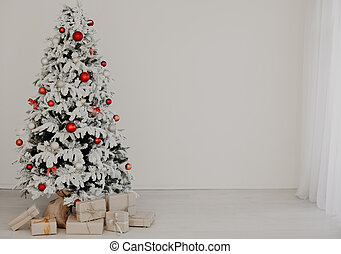 Christmas tree with gifts of the new year home background