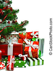 Christmas tree with heap of red gift boxes decorated with ...