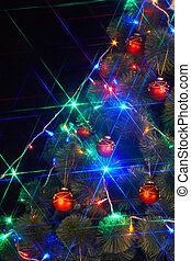 Christmas  tree with light and flash. Black background.
