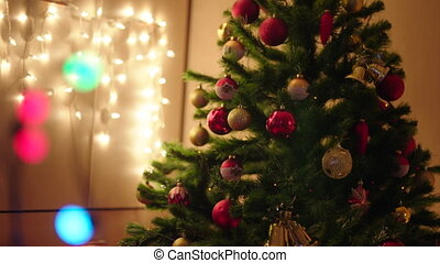 Christmas tree with lights, garland and decoration