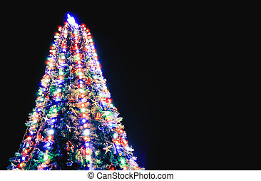 Christmas tree with lights on blue background