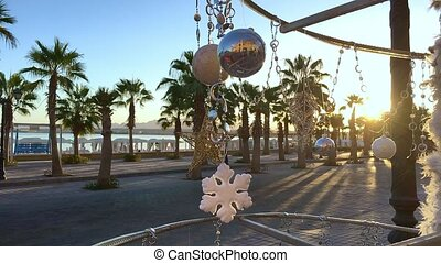 Christmas tree with palm background and sea