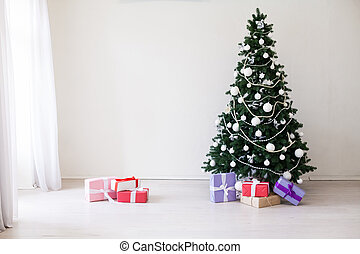 Christmas tree with presents in winter for the new year