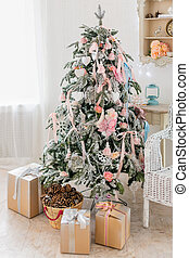 Christmas tree with presents. Pastel pink and blue interior decorations for New Year celebration.