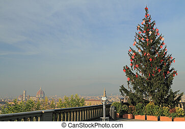 christmas tree with red lilies on Piazzale Michelangelo with...