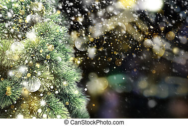Christmas tree with snow falling in the winter