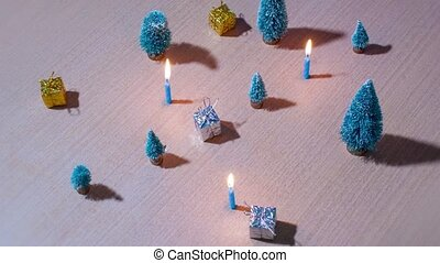 Christmas trees and gifts with candles burning in timelapse