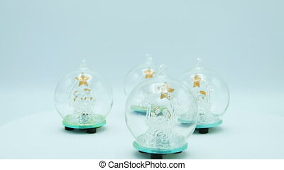 Christmas Trees close up inside crystal balls on white background.